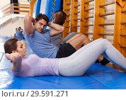 Купить «People warming up at gym», фото № 29591271, снято 31 октября 2018 г. (c) Яков Филимонов / Фотобанк Лори