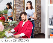 Купить «Cheerful woman professional hairdresser cut male's hair in hairdressing salon», фото № 29592075, снято 25 апреля 2018 г. (c) Яков Филимонов / Фотобанк Лори