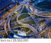 Купить «Night view of overpass interchange», фото № 29592091, снято 10 сентября 2018 г. (c) Яков Филимонов / Фотобанк Лори