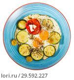 Купить «Image of plate with fried eggs with tomatoes and zucchini», фото № 29592227, снято 18 июля 2019 г. (c) Яков Филимонов / Фотобанк Лори