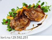 Купить «Close up of delicious fried pork chops with avocado and berries», фото № 29592251, снято 17 июля 2019 г. (c) Яков Филимонов / Фотобанк Лори