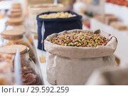 Купить «Illustration of bag with pistachios», фото № 29592259, снято 4 сентября 2017 г. (c) Яков Филимонов / Фотобанк Лори