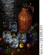 Купить «Christmas still life with gin at bottle and glasses», фото № 29595071, снято 28 октября 2013 г. (c) Короленко Елена / Фотобанк Лори