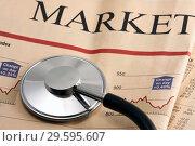 Купить «Стетоскоп на газете с финансовыми новостями», фото № 29595607, снято 23 января 2010 г. (c) Александр Гаценко / Фотобанк Лори