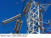 Купить «Опора ЛЭП с высоковольтными проводами на фоне голубого неба», фото № 29595627, снято 2 января 2009 г. (c) Александр Гаценко / Фотобанк Лори