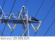Купить «Опора ЛЭП с высоковольтными проводами на фоне голубого неба», фото № 29595631, снято 30 января 2010 г. (c) Александр Гаценко / Фотобанк Лори