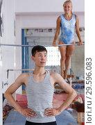 Купить «Sporty couple training on floor», фото № 29596083, снято 18 июля 2018 г. (c) Яков Филимонов / Фотобанк Лори