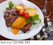 Купить «Well done beef loin fried with cheese», фото № 29596183, снято 26 мая 2019 г. (c) Яков Филимонов / Фотобанк Лори