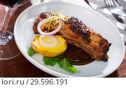 Купить «Broiled pork ribs in chocolate sauce with baked potato», фото № 29596191, снято 17 июля 2019 г. (c) Яков Филимонов / Фотобанк Лори
