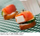 Купить «Canape with salted salmon», фото № 29596327, снято 23 марта 2019 г. (c) Яков Филимонов / Фотобанк Лори