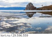 Купить «Lake Baikal in the spring. Reflection of a cloudy sky in blue water with melting ice floes near the famous Shaman Rock on Olkhon Island», фото № 29596559, снято 17 мая 2013 г. (c) Виктория Катьянова / Фотобанк Лори