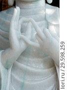 Купить «Thien Hoa buddhist pagoda. Marble Buddha statue. Mudra. Close-up. Cai be. Vietnam.», фото № 29598259, снято 21 марта 2019 г. (c) age Fotostock / Фотобанк Лори