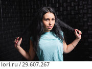 Купить «Portrait of a cheerful brunette», фото № 29607267, снято 7 января 2016 г. (c) Сергей Сухоруков / Фотобанк Лори