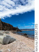 Lake Baikal. Cozy shallow bay with a pebble beach on the coast of Olkhon Island on a sunny day. Стоковое фото, фотограф Виктория Катьянова / Фотобанк Лори