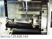 Купить «Milling metalworking process. Industrial CNC metal machining by vertical mill.», фото № 29608143, снято 15 мая 2018 г. (c) Дмитрий Калиновский / Фотобанк Лори