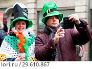 Купить «Performers take part in the annual St. Patrick's Day Parade in central London, as tens of thousands of people watch the parade. Saint Patrick's Day, or...», фото № 29610867, снято 18 марта 2018 г. (c) age Fotostock / Фотобанк Лори