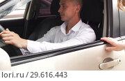 Купить «Young Businessman In Formal Wear With Car Key», видеоролик № 29616443, снято 12 июля 2018 г. (c) Pavel Biryukov / Фотобанк Лори