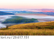 Купить «Misty morning over the valley in the Ural mountains», фото № 29617151, снято 30 августа 2018 г. (c) Акиньшин Владимир / Фотобанк Лори