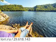 Купить «A tourist sits on the bank of the Yumaguzinsky reservoir on the Belaya River. Bashkortostan», фото № 29618143, снято 30 августа 2018 г. (c) Акиньшин Владимир / Фотобанк Лори