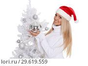 Купить «Young woman in Santa Claus cap», фото № 29619559, снято 22 октября 2013 г. (c) Мельников Дмитрий / Фотобанк Лори