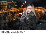 Купить «Cheerful young blonde in black clothes posing.», фото № 29620027, снято 16 января 2016 г. (c) Сергей Сухоруков / Фотобанк Лори