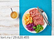 Купить «sliced aspic of beef tongue with salad», фото № 29620455, снято 18 декабря 2018 г. (c) Oksana Zh / Фотобанк Лори