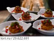 Купить «A Portion of potato snack with pomegranate», фото № 29622691, снято 6 апреля 2018 г. (c) Володина Ольга / Фотобанк Лори