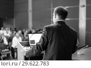 Купить «Public speaker giving talk at Business Event.», фото № 29622783, снято 3 июля 2014 г. (c) Matej Kastelic / Фотобанк Лори