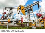 Купить «Working pump jack fracking crude extraction machine», фото № 29623227, снято 10 июня 2018 г. (c) FotograFF / Фотобанк Лори