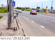 Купить «Traffic enforcement camera and vehicles in motion on city street», фото № 29623243, снято 12 июня 2018 г. (c) FotograFF / Фотобанк Лори