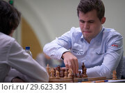 Купить «Чемпион мира Magnus Carlsen, Норвегия (справа) на чемпионате мира по быстрым шахматам в Санкт-Петербурге», фото № 29623351, снято 28 декабря 2018 г. (c) Stockphoto / Фотобанк Лори