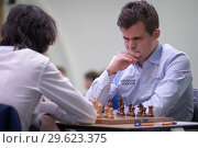 Купить «Чемпион мира Magnus Carlsen, Норвегия (справа) на чемпионате мира по быстрым шахматам в Санкт-Петербурге», фото № 29623375, снято 28 декабря 2018 г. (c) Stockphoto / Фотобанк Лори
