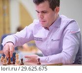 Купить «Чемпион мира Magnus Carlsen, Норвегия на чемпионате мира по блиц-шахматам в Санкт-Петербурге», фото № 29625675, снято 28 декабря 2018 г. (c) Stockphoto / Фотобанк Лори