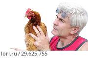 Купить «Mature Gray-haired man Farmer holding a laying hen in his hands.», фото № 29625755, снято 1 мая 2008 г. (c) Акиньшин Владимир / Фотобанк Лори