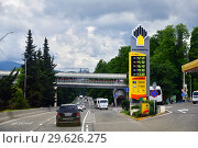 Купить «Sochi, Russia - June 5. 2018. Overhead pedestrian crossing on highway A-147 from Adler to Sochi», фото № 29626275, снято 2 июня 2018 г. (c) Володина Ольга / Фотобанк Лори