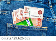 Купить «Credit card Visa with banknotes of russian roubles», фото № 29626635, снято 23 декабря 2015 г. (c) FotograFF / Фотобанк Лори