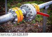 Купить «Pipeline with control valve for crude oil», фото № 29626839, снято 10 июня 2018 г. (c) FotograFF / Фотобанк Лори