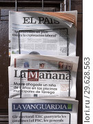 Купить «Spain, Catalonia, Lleida, at Pobla de Segur. newspapers», фото № 29628563, снято 24 июня 2018 г. (c) age Fotostock / Фотобанк Лори