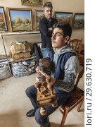 Azerbaijan, Sheki, Nukha Fortress, young man playing traditional Tar, stringed instrument with instructor, MR. Стоковое фото, фотограф Walter Bibikow / age Fotostock / Фотобанк Лори