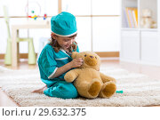 Купить «little girl doctor with teddy bear», фото № 29632375, снято 24 июня 2019 г. (c) Оксана Кузьмина / Фотобанк Лори