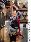 Купить «Mature male wine maker corking bottle of wine», фото № 29632931, снято 16 января 2019 г. (c) Яков Филимонов / Фотобанк Лори