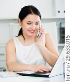 Купить «Woman using phone in office», фото № 29633015, снято 30 марта 2017 г. (c) Яков Филимонов / Фотобанк Лори