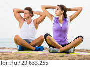 Купить «Couple training yoga on beach», фото № 29633255, снято 16 января 2019 г. (c) Яков Филимонов / Фотобанк Лори
