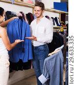 Купить «Couple purchasing jacket», фото № 29633335, снято 24 октября 2016 г. (c) Яков Филимонов / Фотобанк Лори