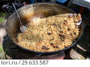 Купить «Cooking traditional Uzbek pilaf in a large cauldron», фото № 29633587, снято 30 июня 2018 г. (c) FotograFF / Фотобанк Лори
