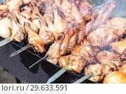 Купить «Appetizing shashlik from chicken meat on metal skewers», фото № 29633591, снято 30 июня 2018 г. (c) FotograFF / Фотобанк Лори