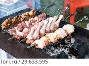Купить «Grilled shish kebab or shashlik from chicken meat on metal skewers», фото № 29633595, снято 30 июня 2018 г. (c) FotograFF / Фотобанк Лори