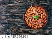 Купить «italian penne arrabiata in a clay bowl», фото № 29636931, снято 21 декабря 2018 г. (c) Oksana Zh / Фотобанк Лори