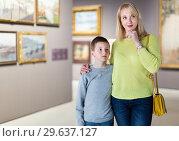 Купить «Mother and son regarding paintings in halls of museum», фото № 29637127, снято 18 марта 2017 г. (c) Яков Филимонов / Фотобанк Лори