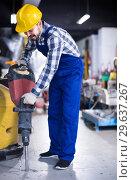 Купить «working man practicing his skills with pneumatic drill at workshop», фото № 29637267, снято 17 января 2017 г. (c) Яков Филимонов / Фотобанк Лори